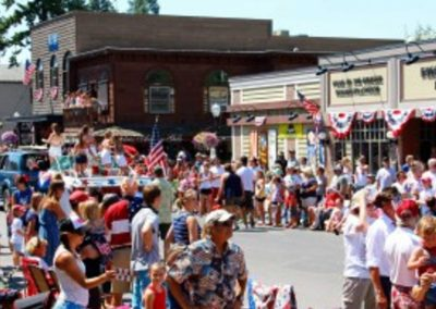 crowds of people along the Bigfork parade route