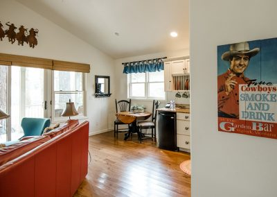 Cottage living room and hallway, and cowboy poster