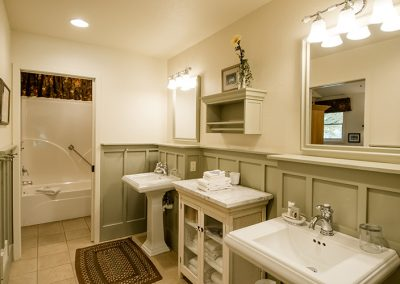 Cottage batrhoom with pedestal sinks