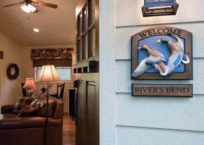 Cottage entrance and River's Bend sign