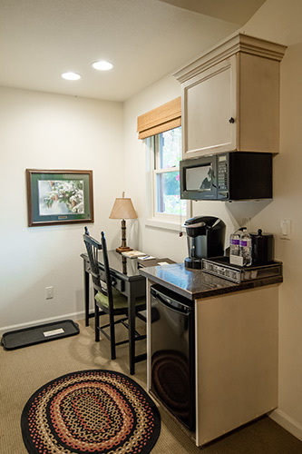 Cottage fridge, microwave, and writing desk